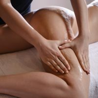 Anti cellulite massage for young woman in beauty salon. Perfect skin fat burning beauty concept